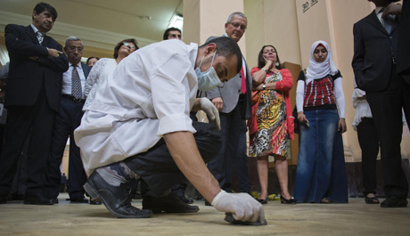 A worker clean the floor of the Egyptian museum