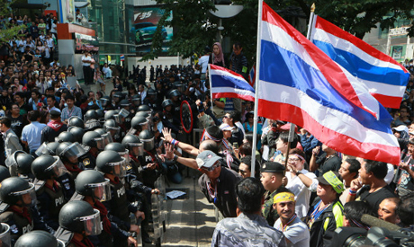 Anti-government protesters holding Thai national flags
