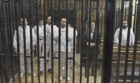 Mohamed Morsi in the cage during his trail