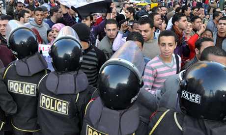 Demonstrators confront riot police