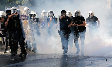 Turkish Riot police use tear gas