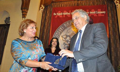 Pubisher Fatma El-Boudy holds the prize(L) with Syrian Writer Khaled Khalifa