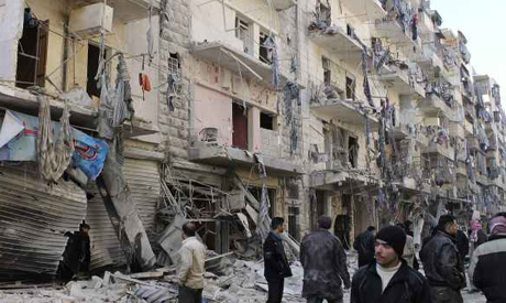 People inspect a damaged site an air raid in Aleppo