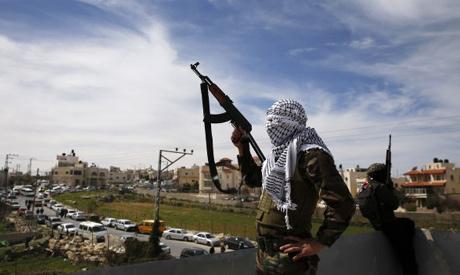Masked Palestinian gunmen