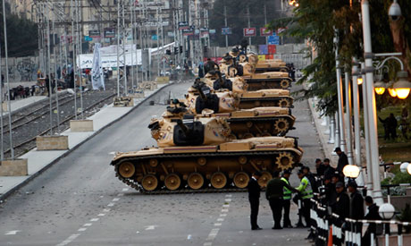 Tanks are positioned in front of the presidential palace in Cairo