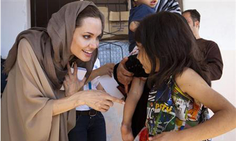 Angelina Jolie meets Syrian refugees in the Bekaa Valley, Lebanon in September. (Photo: Reuters)