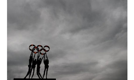 Sculpture of people carrying Olympic rings, November, 2012 in Lausanne. (Photo: AFP)