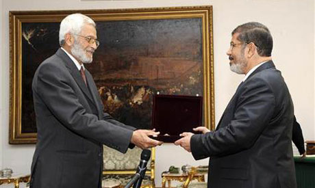Morsi shaking hands with Constituent Assembly