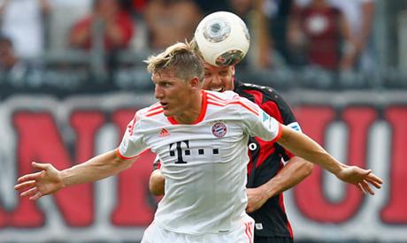 Bastian Schweinsteiger (L) of Bayern Munich
