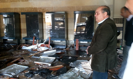 Arab inspects the damages inside the NLA