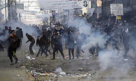 Supporters and opponents of ousted Egyptian President Mohamed Morsi clash at Nasr City