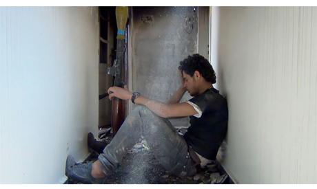 """Still from """"Return to Homs"""""""