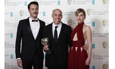 "Oppenheimer celebrates winning Best Documentary for ""The Act Of Killing"" with Huston and Poots at th"