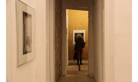Visitor inspects artwork at The House of Rare Historic Photographs exhibition, Townhouse Gallery. (P