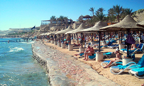Tourists are seen at a beach in the Red Sea resort of Sharm el-Sheikh