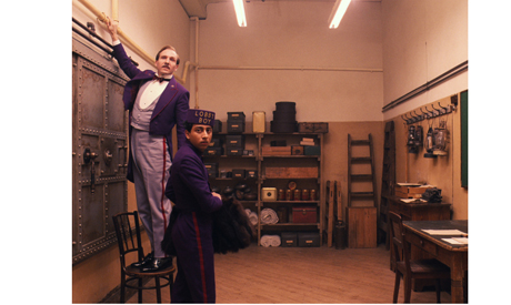 """This image released by Fox Searchlight shows Ralph Fiennes, left, and Tony Revolori in """"The Grand Bu"""