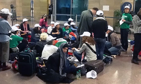 Gaza-bound female activists protest at Cairo airport