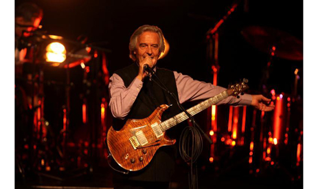 British Jazz musician John McLaughlin performs with 4th Dimension at a concert in the West Bank city