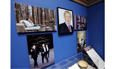 A portrait of former British Prime Minister Blair, painted by former U.S. President Bush, hangs on d