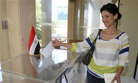 Egyptian expatriate living in Lebanon, casts her ballot at a polling station
