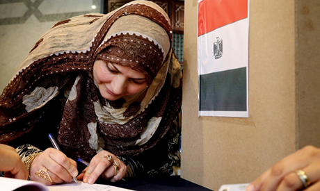An Egyptian woman registers at a polling station