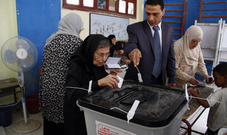 woman casts her vote
