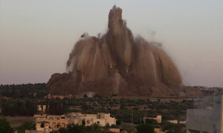Debris rises during what rebel fighters said was an operation in which they blew up a tunnel