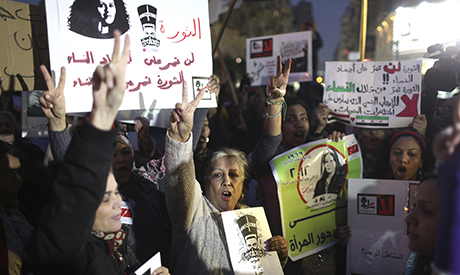 Women chant slogans as they participate in a protest against sexual harassment