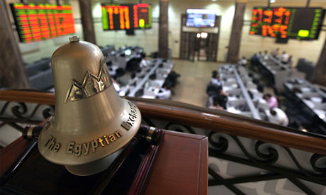 Traders are seen working below the Egyptian Exchange bell at the stock exchange