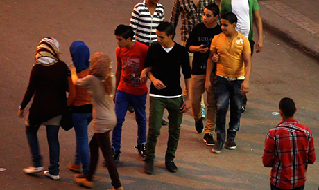 group of young men harass three girls in Cairo