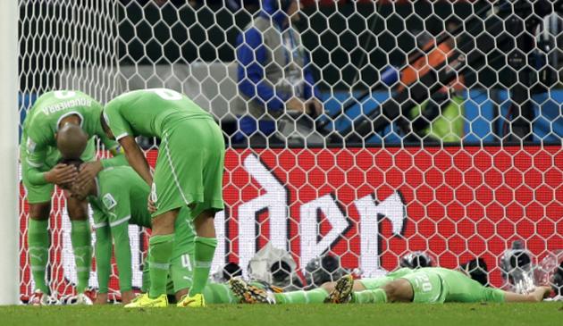 Algerian players react