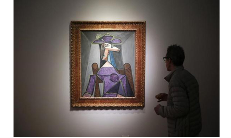 A man looks at Pablo Picasso