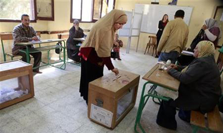 A woman casts her vote