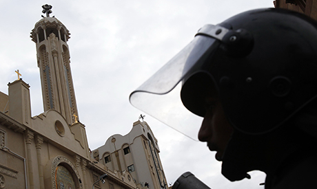 An Egyptian riot police is seen outside the Coptic Orthodox church