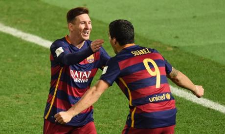 Barcelona forward Luis Suarez celebrates with Barcelona forward Lionel Messi