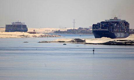 Cargo Ships cross the Suez canal