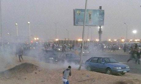 Police fire tear gas in clashes with supporters of Egypt