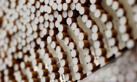 Cigarettes are seen during the manufacturing process (Photo: Reuters)