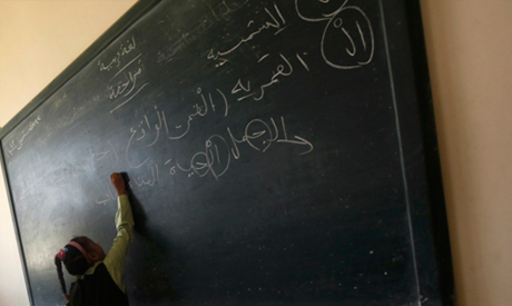 A girl writes on the blackboard