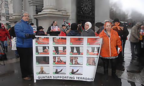 Egyptians hold a banner in front of the Qatari embassy in London