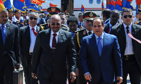 Egyptian President Abdel-Fattah El-Sisi walks with Sudan