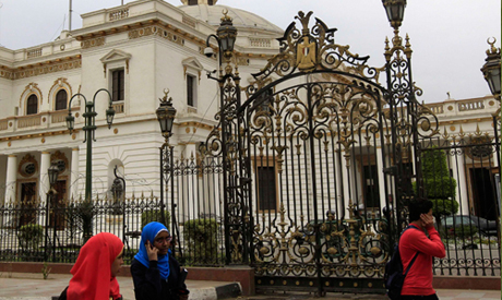 People walk in front of parliament in Cairo