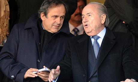 UEFA president Michel Platini, left, talks with FIFA former president Sepp Blatter