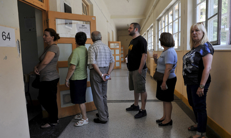 People line up outside a polling station in Greece