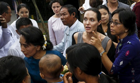Myanmar pro-democracy leader Aung San Suu Kyi and UNHCR special envoy Angelina Jolie