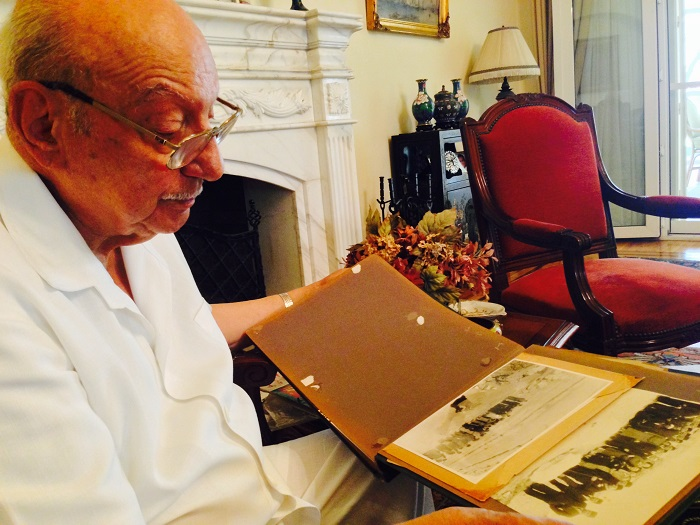 Ambassador Ahmed Hassan with old Album of his father Selim Hassan