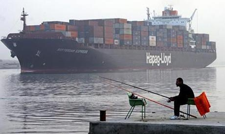 A cargo ship makes its way along the Suez Canal (Photo: Reuters)