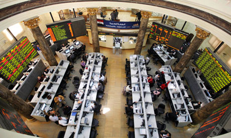 Egyptian traders work on the floor of the stock market