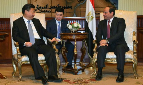 gyptian Presidency shows Egyptian President Abdel Fattah al-Sisi (R) meeting with Chinese President