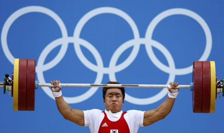 South Korea's Sa Jae-hyouk lifts during the men's 77Kg Group A weightlifting  competition at the ExCel venue at the London 2012 Olympic Games (Reuters)